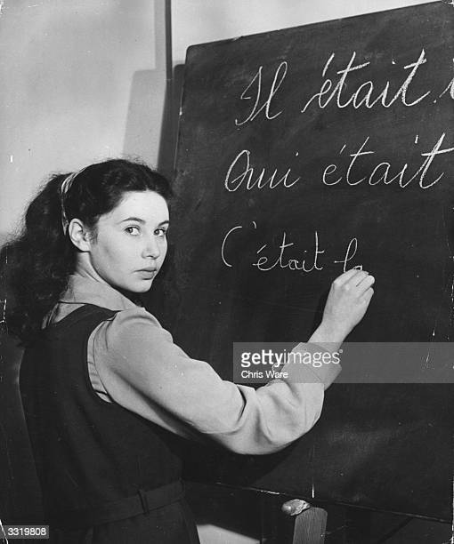 Sixteen-year-old schoolgirl actress June Rodney, who has already appeared in several films, at work during a French lesson at Aida Foster's School.