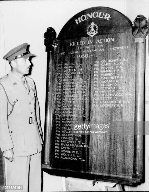 Sixth Birthday of Ist Battalion Royal Australian RegimentLieut Col I Ferguson CO of Battalion with the Honour Roll inscribed with the named of the...