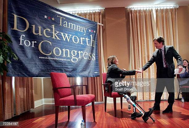 Sixth congressional district Democratic Candidate Tammy Duckworth shakes hands with actor and activist Michael J Fox after he delivered a speech on...