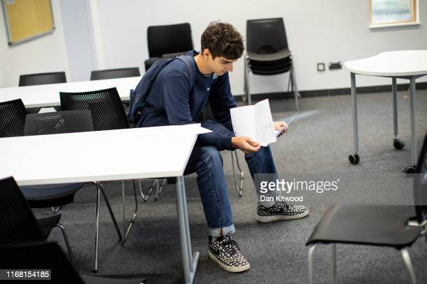 Sixth form student receives their ALevel results at Stoke Newington School on August 15 2016 in London England Over 300000 teenagers are getting the...