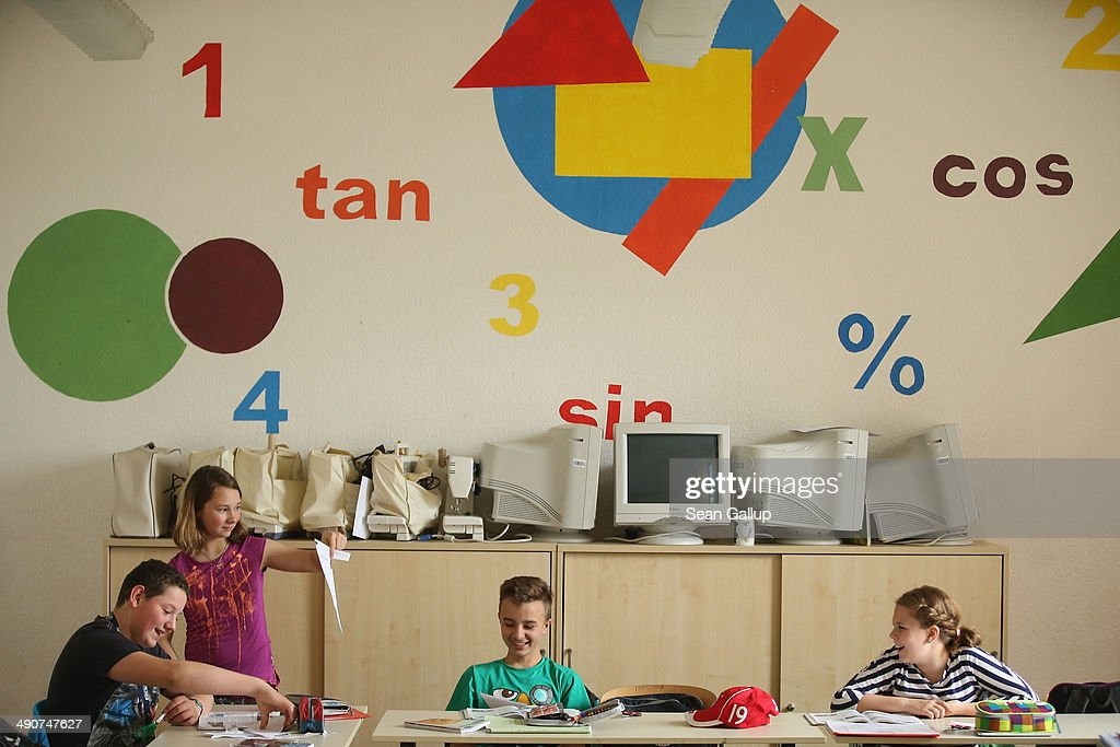 Sixth grade students (from L to R) Sandro Guettler, Sophie Urban, her brother Anton Urban and Leoni Knappe attend class at the Middle School on May 14, 2014 in Seifhennersdorf, Germany. The state of Saxony officially closed the Seifhennersdorf Middle School in 2012 after only 38 students registered, two short of the 40 the state required to keep the school open. Rather than agree to the school's closing, a group of parents and other volunteers have since assumed the duties of teachers and staff themselves and are trying to get recognition of their 'illegal' school through a court case that now lies with Germany's Federal Constitutional Court. Eleven 6th graders attend the school, even though the state does not recognize their enrollment. School closings across Germany have reached epidemic proportions with 6,100 closures between 2003 and 2013, due in large part to Germany's low birth rate, a phenomenon typical across much of Europe. In Saxony the low birth rate has combined with a steady migration of young people to big cities and to western Germany and the number of schoolchildren has fallen by close to 50% and led to the closure of 1,000 out of a total of 2,500 state schools since 1989.