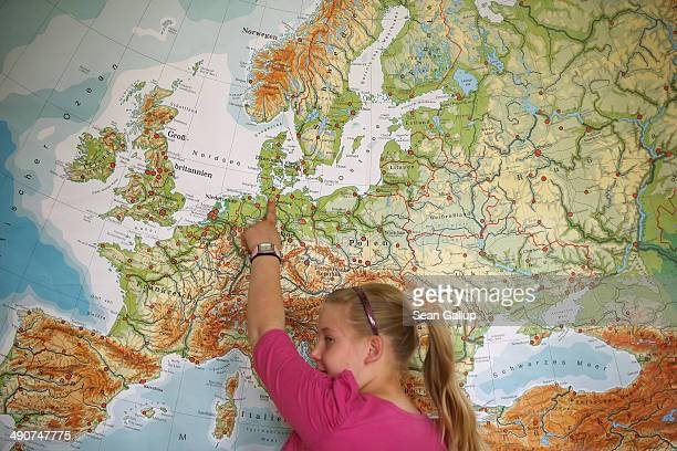 Sixth grader Linda Weitz points to the city of Hamburg on a map of Europe during a lecture on the Hanseatic League in history class at the Middle...