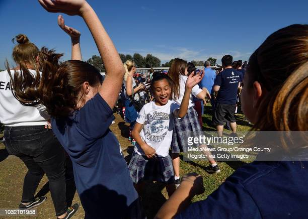 Sixth grader Tiana Sinon center joins her classmates as they break a world record for largest freeze dance at St Joseph Catholic School in Placentia...