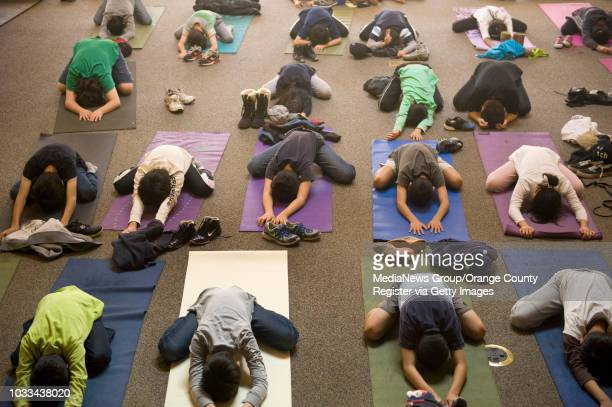 Sixth graders at Stonegate Elementary School in Irvine are put through yoga exercises by certified yoga instructor Meleah Shank Firstgrade teacher...