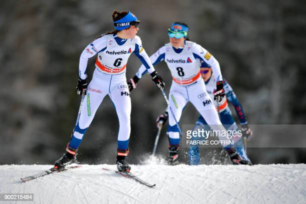 Sixth placed Kerttu Niskanen and fourth placed Krista Parmakoski both of Finland compete the Women's 10 km pursuit free during the cross country FIS...