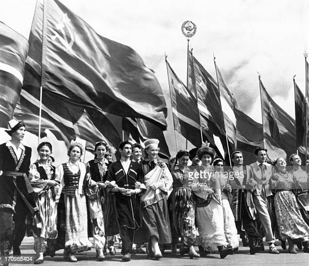Sixth world festival of youth and students in moscow july 28 delegates of the soviet union representing all 15 republics marching in lenin stadium...