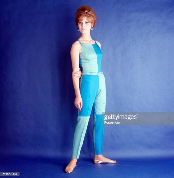 Sixties Fashion A young female model wears a blue and aquamarine checked two piece sunsuit circa 1963