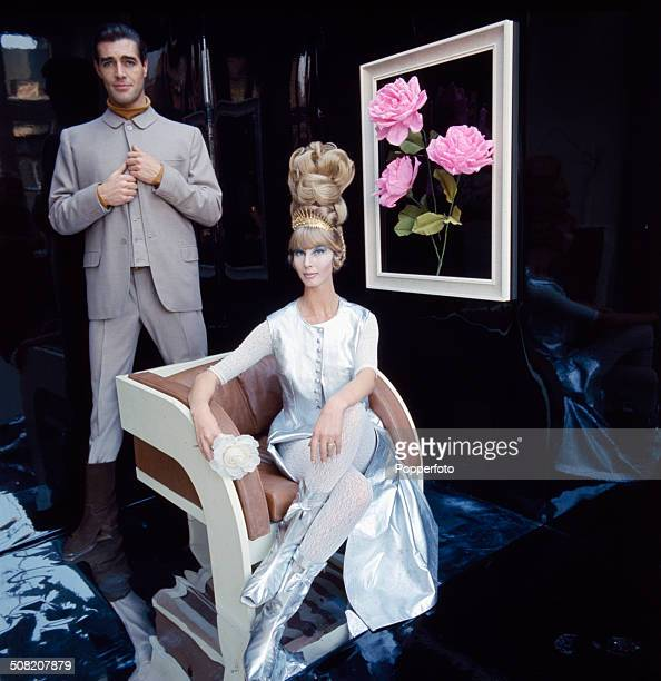 Sixties Fashion female and male fashions of the future complete with elaborate beehive hairstyle as imagined in 1965