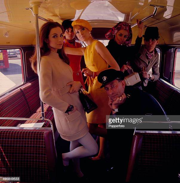 Sixties Fashion Five young female models wearing fashionable clothes pose with a bus conductor inside a London Transport Routemaster bus in 1967