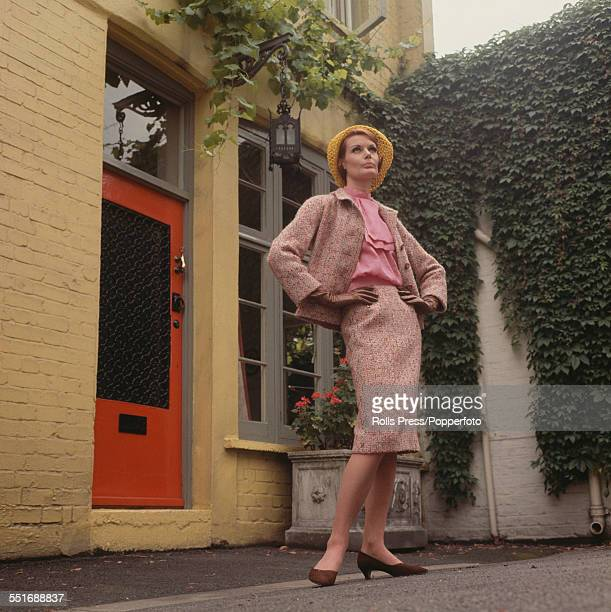 Sixties Fashion - Model Alexis Drury wears a vivid tweed skirt suit entitled 'Seurat' over a blouse of bright pink chiffon with a tom jones cravat...