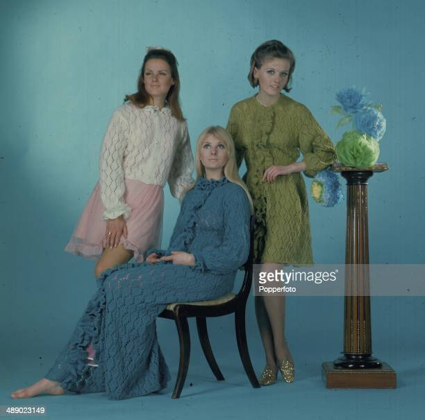 Sixties Fashion Three young female models wear knitted garments including a bedjacket housecoat and dressing gown