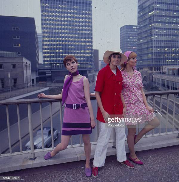 Sixties Fashion Three young female models wear towelling fashion outfits posed on a bridge overlooking the City of London in 1967 The model in the...