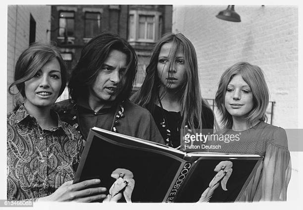 Sixties icons Christine Keeler Penelope Tree and Marianne Faithfull join photographer David Bailey around a copy of his book of sixties photographs...