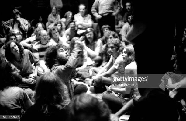 Sixties radical Jerry Rubin sits with a group of DJ's and writers during The Alternative Media Conference on June 1720 1970 at Goddard College in...