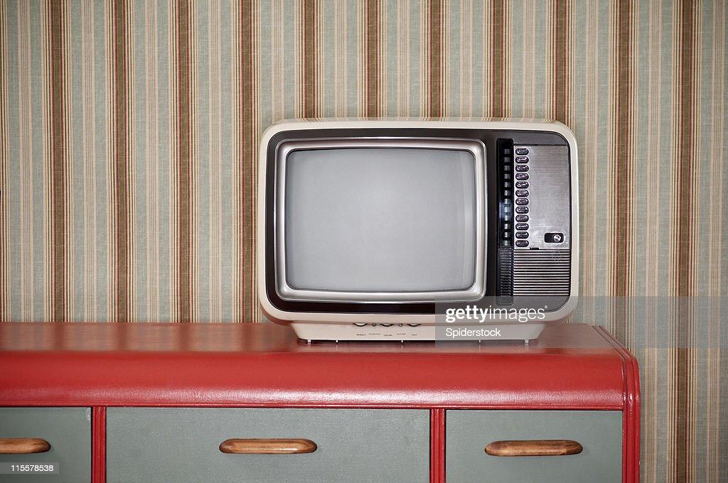 Sixties TV On Retro Desk : Stock Photo