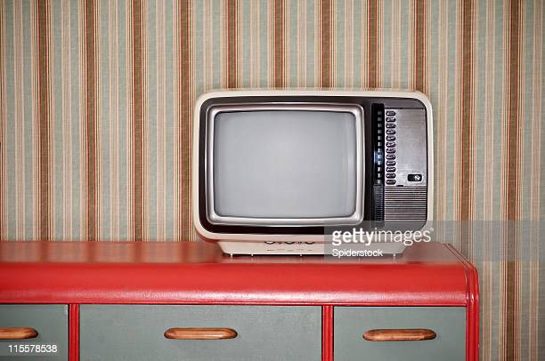 sixties tv on retro desk - television show stock pictures, royalty-free photos & images