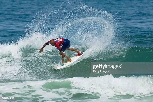 Sixtime ASP world champion Kelly Slater of Cocoa Beach Florida USA slashes a backside turn en route to posting a win over Kalani Robb of Kauai Hawaii...