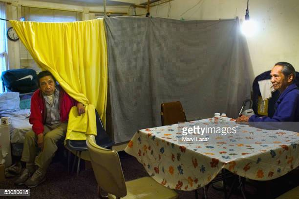 Sixto Gagni and Pedro Dosono sit in their home May 4 2005 in San Francisco To save money on rent the two share a converted onebedroom apartment in...