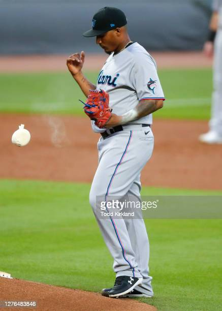 Sixto Sanchez of the Miami Marlins drops the rosin bag in the first inning of an MLB game against the Atlanta Braves at Truist Park on September 23,...