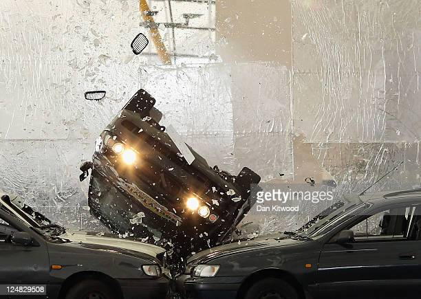 Sixty four year old Hollywood movie stuntman Rock Taylor drives through a huge sheet of glass at the 02 Arena on September 13 2011 in London England...