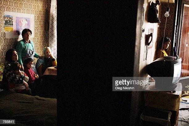 Sixty four year old refugee Ninely Kandeladze watches television in her room she shares with five other people April 2 2002 in the Hotel Iveriya in...
