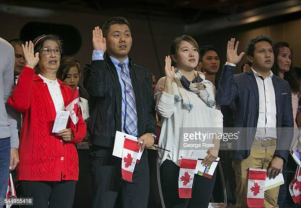 Sixty new citizens from 26 countries swear their allegiance to their new nation during a special Canada Day ceremony on July 1 2016 in Vancouver...