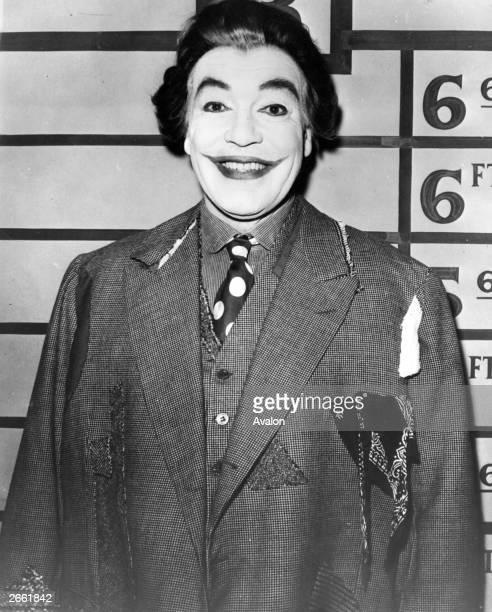 Sixty year-old American actor Cesar Romero, previously famous for his good looks, measures up as The Joker, a devious villain in the 'Batman'...