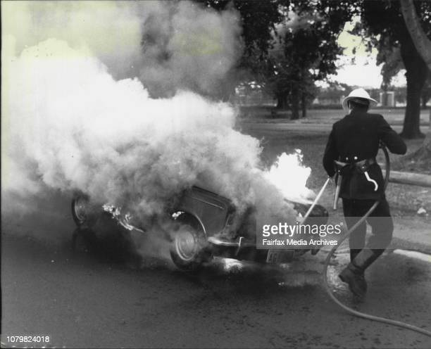 Sixtyfiveyearold Tindaro Merlo of Paddington Woollahra firemen extinguish his burning car in Lang Road Moore Park todayHe was driving along the road...