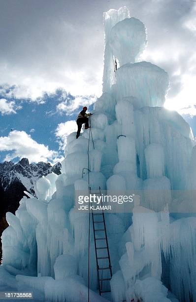 Sixtynineyearold hotel owner Josef Strobl works on his 23 meters high icesculpture in the southern Tirolian village of Dobbiaco Italy 13 February...