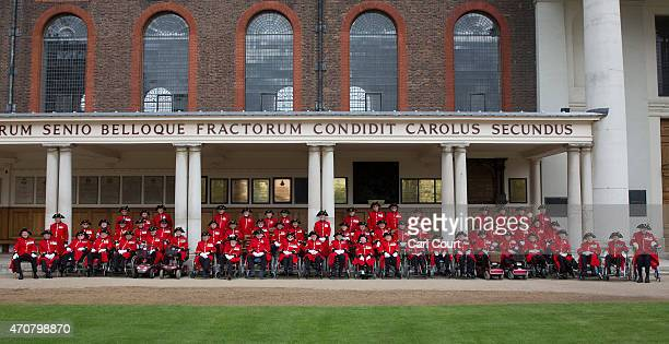 Sixtythree Chelsea Pensioners who served in World War II pose for a photograph to commemorate the 70th anniversary year of Victory in Europe at Royal...