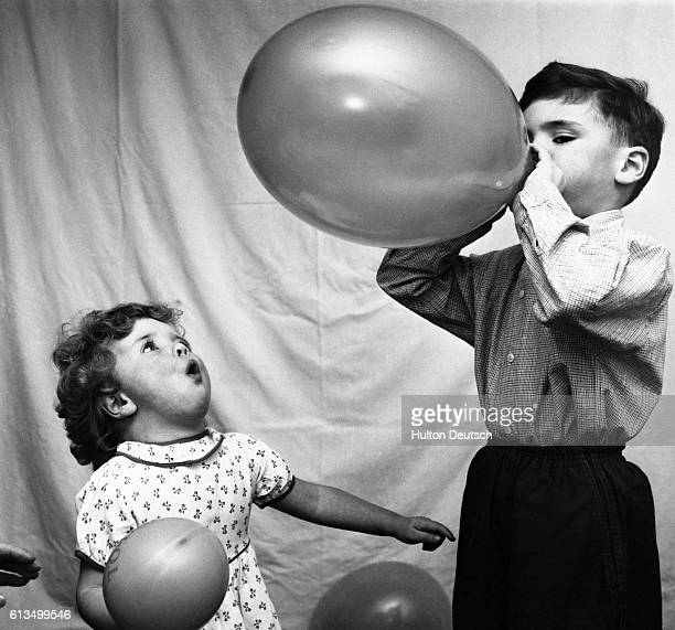 Sixyear old Stephen Burton and his sister Susan play with balloons
