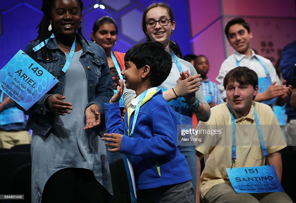 Six-year-old Akash Vukoti (C) of San Angelo, Texas, bids farewell to other spellers as he leaves the stage after he misspelled his word in round three of the 2016 Scripps National Spelling Bee May 25, 2016 in National Harbor, Maryland. Students from across the country gathered to competed for top honor of the annual spelling championship.