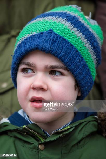 Sixyearold Alfie Dingley poses outside Portcullis House before meeting with MPs in Parliament on March 20 2018 in London England The British...