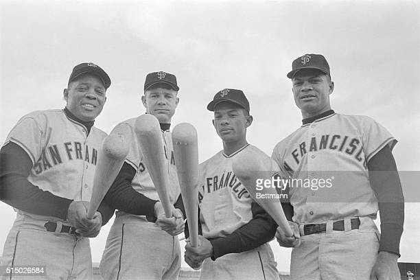 Sixyearold Danny Phillips shoulders a mansized bat in front of San Francisco Giant batman Harvey Kuenn Willie Mays Matty Alou and Felipe Alou here...