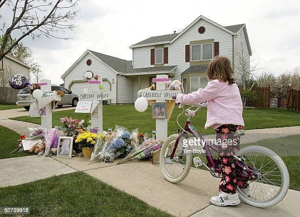 Sixyearold Efrosini Kakotaritis stops her bicycle at a memorial for 9yearold Christian and 3yearold Grace Vasilev in front of their home April 30...