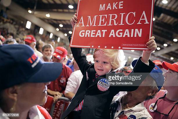 Sixyearold Eli Townsend dresses like Republican presidential nominee Donald Trump during a campaign rally at the Jacksonville Equestrian Center...