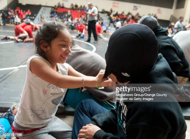Sixyearold Eliana Trevino daughter of coach Rich Trevino has some fun with senior Amaris Montiel during the 2015 Lady Tillers' ÒGo Big or Go HomeÓ...
