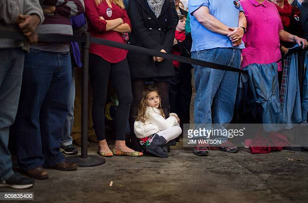 Sixyearold Ella McGrath clings to the legs of her mother Kathryn McGrath as Republican presidential candidate Marco Rubio speaks during a rally in...