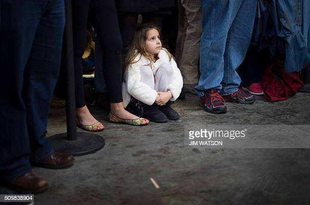 Sixyearold Ella McGrath sits beneath her mother Kathryn McGrath as Republican presidential candidate Marco Rubio speaks during a rally in Greenville...
