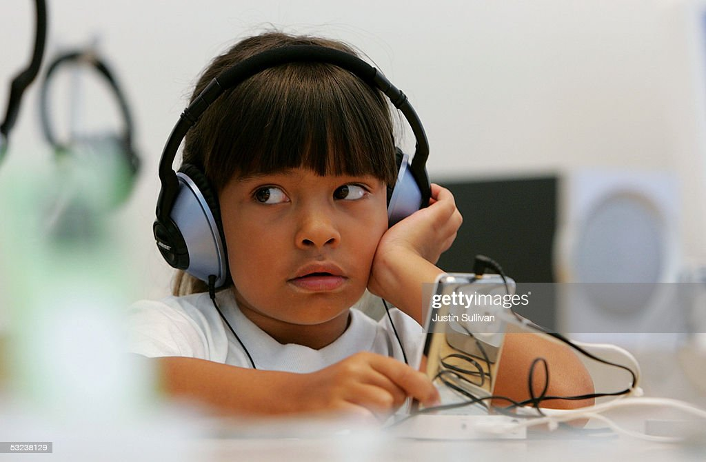 Six-year-old Emma Cordell listens to a new iPod on display at the Apple Store July 14, 2005 in San Francisco, California. Shares of Apple Computer surged Thursday after the company reported its best quarterly profit ever. Apple?s net income rose to $320 million, or 37 cents per share, up from the $61 million and 8 cents per share the company reported in the same quarter last year.