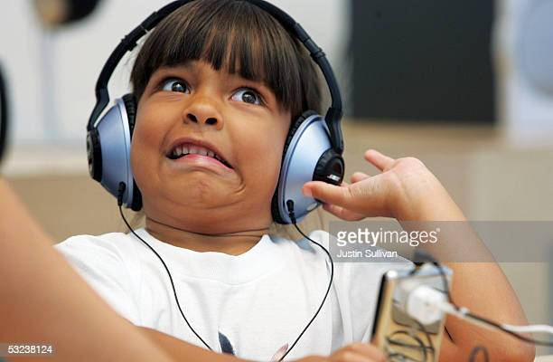 Sixyearold Emma Cordell reacts as she listens to a new iPod on display at the Apple Store July 14 2005 in San Francisco California Shares of Apple...