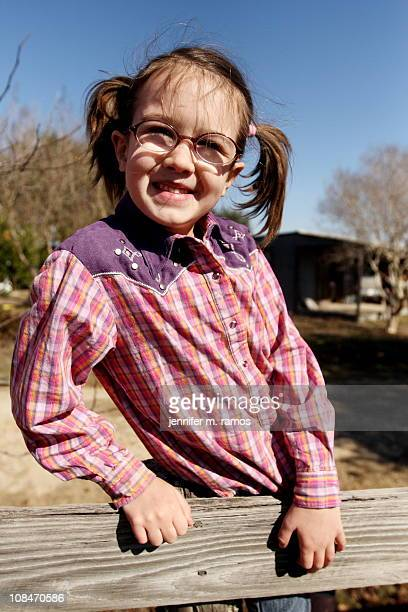 six-year-old girl on a fence