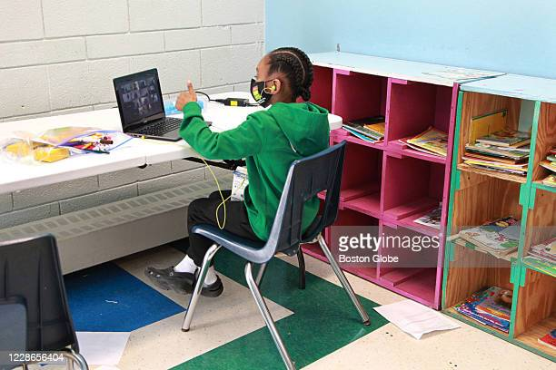 Six-year-old gives the thumbs up to his teacher in his virtual classroom at the Roxbury YMCA in Boston on Sept. 21, 2020. Boston Public School...