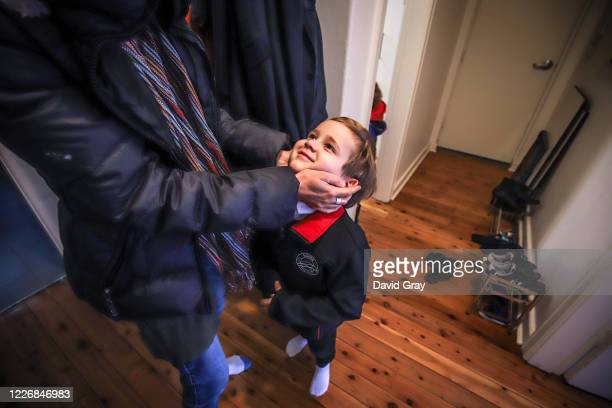 Six-year-old Kaya Atayman is helped by his mother Famona to get dressed as he prepares for school on May 25, 2020 in Sydney, Australia. Students in...