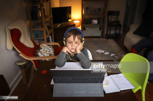 Six-year-old Kaya Atayman sits in front of his computer as he does homeschooling at his home in the suburb of Bondi on May 21, 2020 in Sydney,...