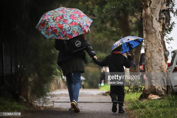 Six-year-old Kaya Atayman walks with his mother Famona to school in the suburb of Bondi on May 25, 2020 in Sydney, Australia. Students in New South...