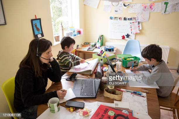 Six-year-old Leo and his three-year old brother Espen complete homeschooling activities suggested by the online learning website of their infant...