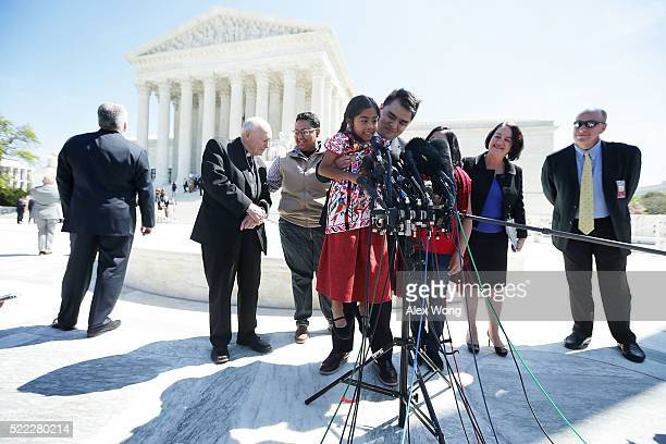 Sixyearold Sophie Cruz of Los Angeles speaks to members of the media in front of the US Supreme Court as Executive Director of National Immigration...