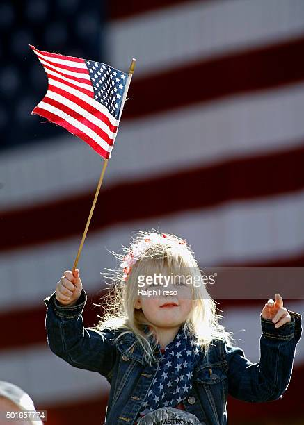 Sixyearold Summer Johnston waves a flag as she waits for the arrival of Republican presidential candidate Donald Trump to a campaign event at the...