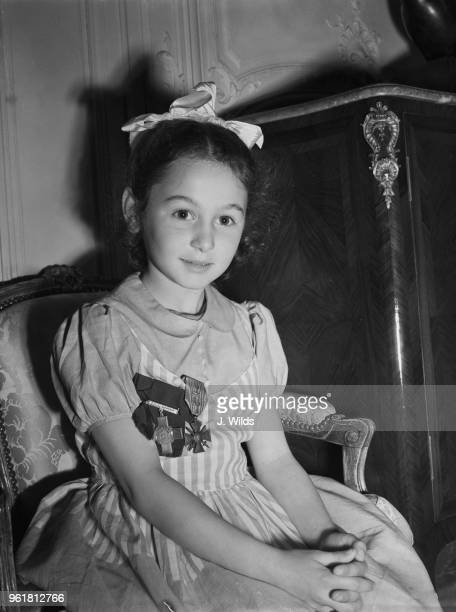 Sixyearold Tania Szabo at the French Embassy in London wearing the George Cross and the Croix de Guerre which has just been awarded posthumously to...